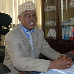 Mr. Hassan Mohamed, OGW. - Commission Secretary