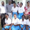 ncic officers with a section of amani club officials of st. alloys girls in kisumu county